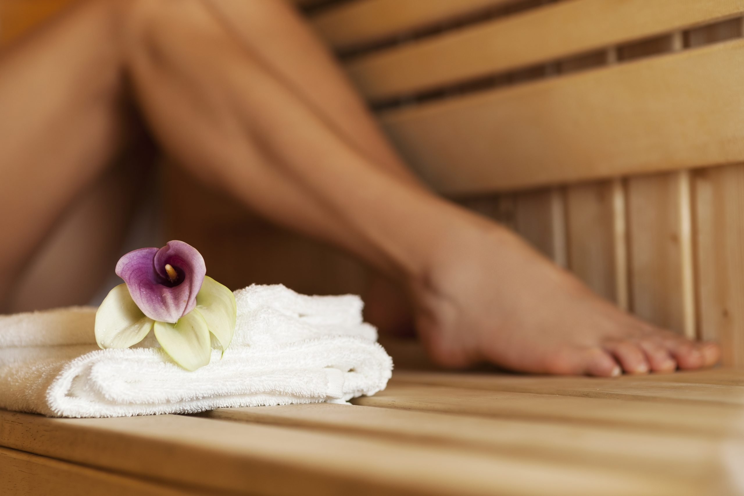 Close up of fresh towels and flowers in sauna
